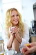 Blond girl at breakfast time talking to boyfriend