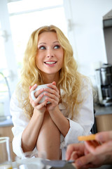 Blond girl at breakfast time talking to boyfriend