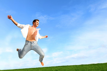 Man jumping in the air with joy
