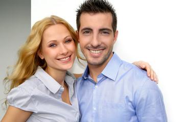 Cheerful couple looking at camera