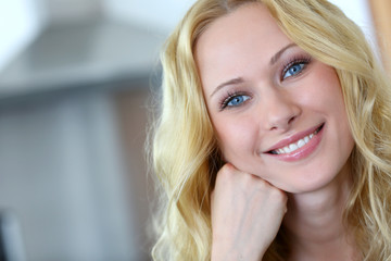 Portrait of smiling blond woman with curly hair