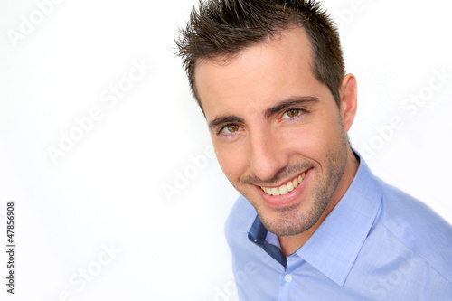 Smiling handsome guy leaning on white background