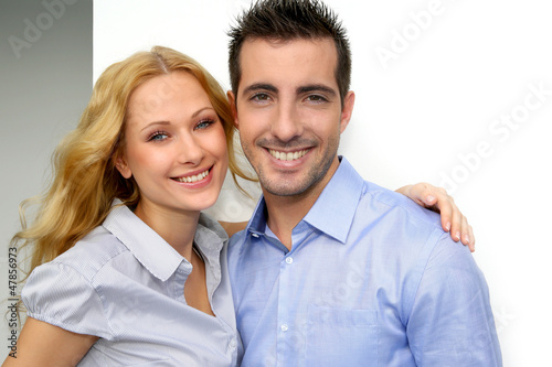 Cheerful couple looking at camera