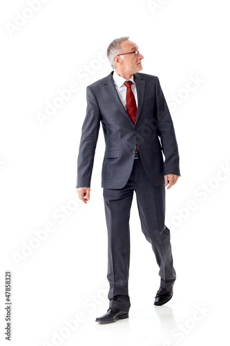 Walking mature business man 5