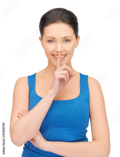 woman making a hush gesture
