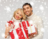 romantic couple in a sweaters with gift boxes