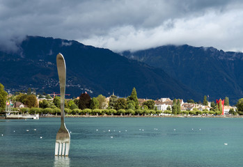 modern sculpture - big fork in water of Geneva lake