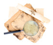 Old paper with magnifying glass isolated on white