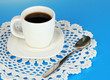 A cup of strong coffee on blue background