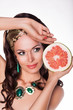 Brunette Holding fresh Grapefruit - Preference Healthy Food