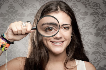 looking at camera through magnifying glass