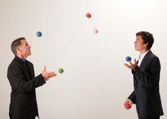 Juggling businessmen
