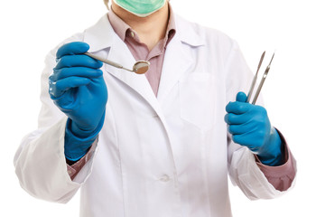 A male dentist with tools in his hands