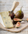Cheese and figs on wooden platter