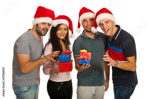 Happy friends with Christmas gifts