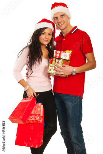 Cheerful young Christmas couple