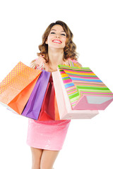 Young cheerful girl with shopping bags isolated on white