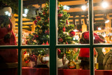 Christmas Tree behind a nicely decorated window