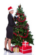 woman arranging  christmas tree