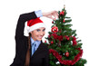 funny woman decorating christmas tree