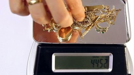gold jewelry on a digital scale
