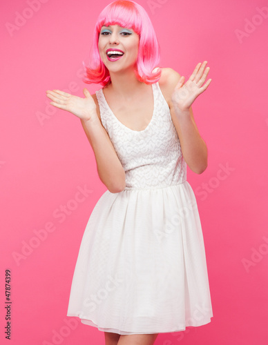 Beautiful young woman over pink background