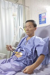 old man patient feeding liquid  food on hospital bed