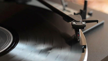 Record player with vinyl record, close up