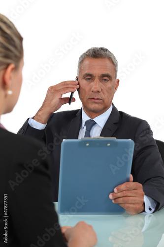 Boss checking colleague's work
