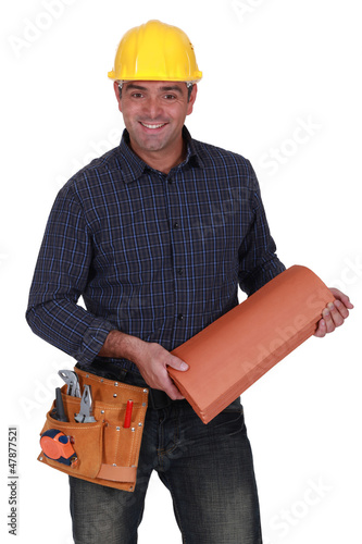 Smiling roofer standing on white background