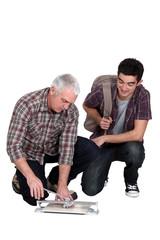 Tiler and apprentice