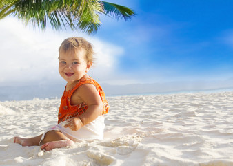 happy smiling baby child on tropical sand beach
