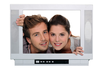 couple posing in a television frame