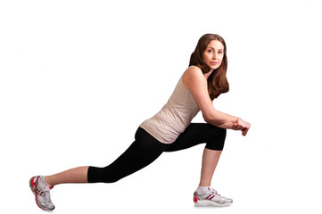 Exercising girl doing lunge exercise
