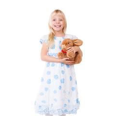 junges Mädchen mit Hasen-Kuscheltier