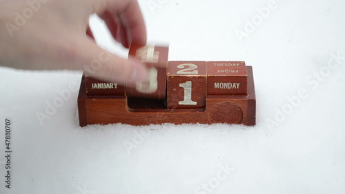 Hand change date retro wooden calendar winter snow new 2013 year