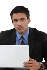 Businessman sat working at his desk
