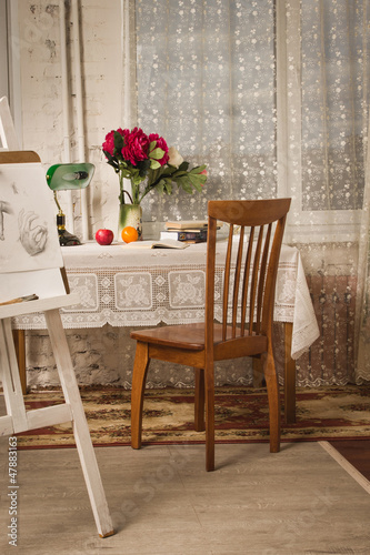Vintage living room with old fashioned table and chair