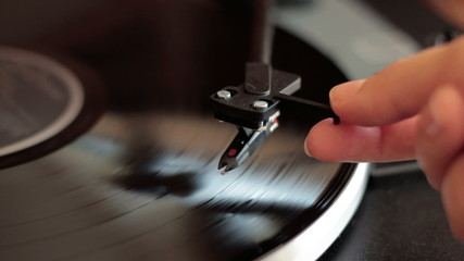 Needle being lowered onto record