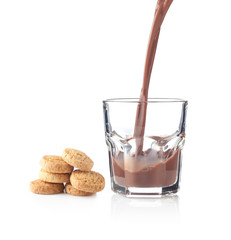 Chocolate splash in a glass with cookies