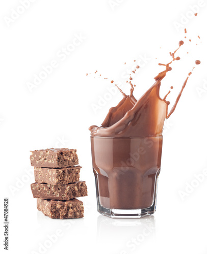 Chocolate splash in a glass with chocolate tablet
