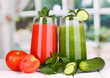 Fresh vegetable juices on wooden table, on window background