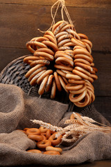 tasty bagels and spikelets on wooden background