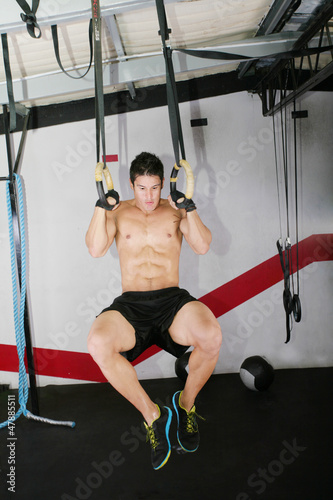 Ring dip crossfit exercise.