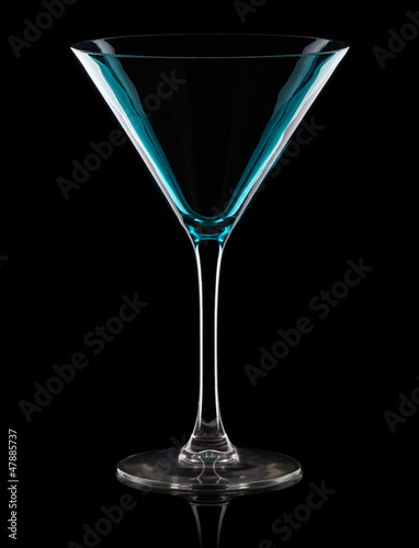 Empty martini glass. Isolated on black background
