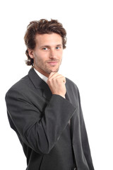 Business attractive young man with a hand on chin