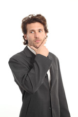 Business attractive young man thinking with a hand on chin