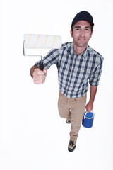 Man holding a paint roller