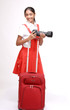 Happy Indian girl with camera and red suitcase