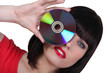 Woman holding a cd to an her eye